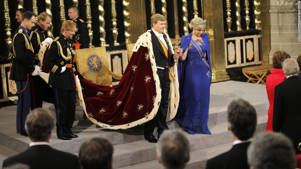 King Willem-Alexander and Queen Maxima prepare to leave after their investiture ceremony at New Church on April 30 in Amsterdam.