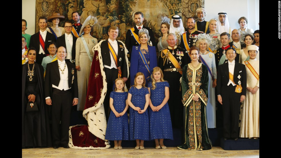 King Willem-Alexander and Queen Maxima pose with guests following their investiture ceremony.