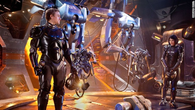 "Robots take on monsters in the film ""Pacific Rim."""