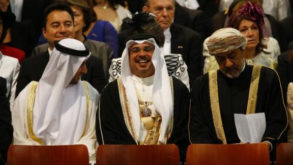 Emirati businessman Sheikh Hamed bin Zayed al Nahyan, left, attends the investiture ceremony.