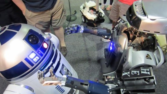 """HEX meets """"R2-D2"""" at a recent Robofest event. Haygood hopes to inspire kids in Baltimore to build robots."""