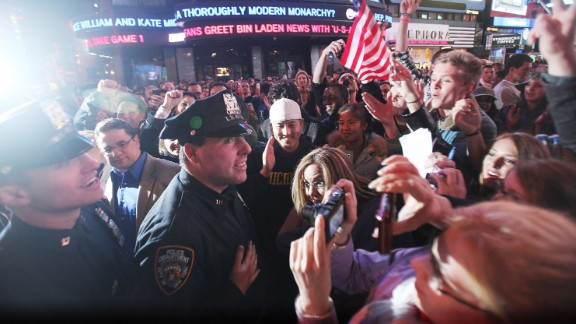 Crowds celebrate with NYPD officers in New York