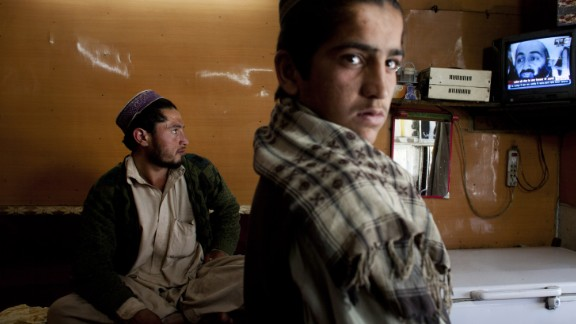 Afghans watch television coverage in Kabul announcing the killing of bin Laden.
