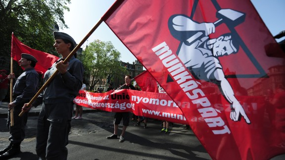 """Members and sympathizers of the Hungarian communist party, the """"Munkaspart,"""" march in Budapest."""