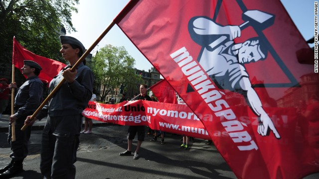 Members and sympathizers of the Hungarian communist party, the 'Munkaspart' (Party of Workers), following the former governor communist party of the Soviet collaborate Kadar regime after the WWII, march in Budapest on May 1, 2013 during their celebration for the International Workers' Day and to protest against the government's policy in Hungary and the power of the multinational companies all over the World. AFP PHOTO / ATTILA KISBENEDEK (Photo credit should read ATTILA KISBENEDEK/AFP/Getty Images)
