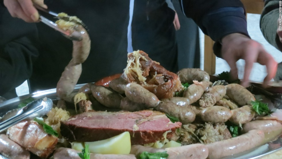 Choucroute garnie is a hearty Alsatian dish of sauerkraut, pork products and boiled potatoes.