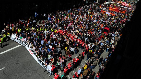 Demonstrators march against the Spanish government