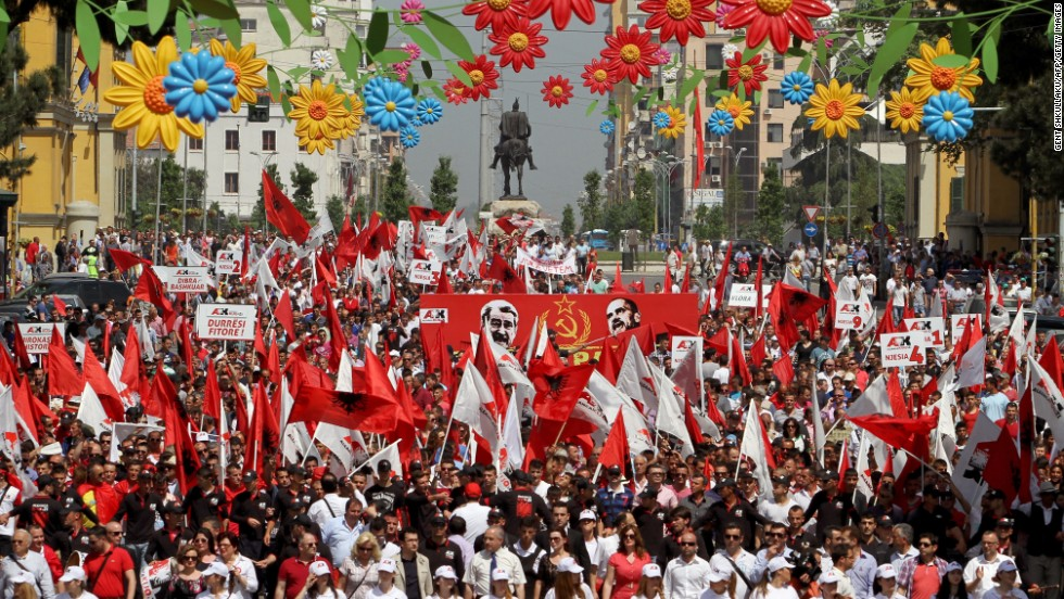 Supporters of the nationalist party Red and Black march in Tirana, Albania, demand the resignation of Premier Sali Berisha.