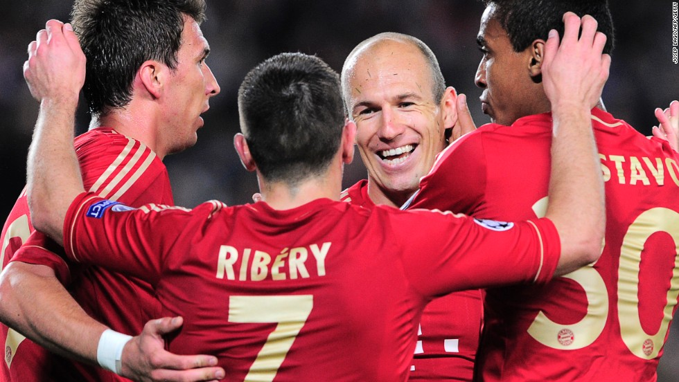 Arjen Robben celebrates with his Bayern Munich teammates after their resounding second leg victory over Barcelona in the Nou Camp.