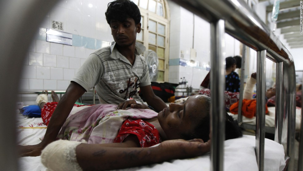 A garment worker rescued from the wreckage of the Rana Plaza building lies in a hospital in Dhaka on Thursday, May 2.