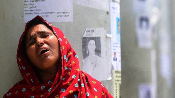 A woman weeps after identifying her daughter