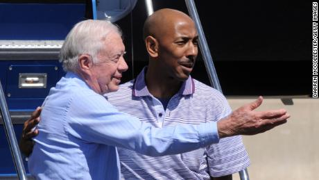 Former President Jimmy Carter and former North Korean detainee Aijalon Gomes arrive in Gomes' hometown of Boston.