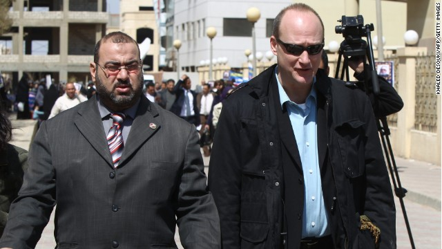 U.S. national Robert Becker, right, leaves court in Cairo after a trial on allegedly illegally funded NGOs on March 8, 2012.