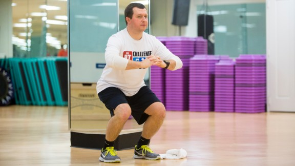 Douglas Mogle does a squat during the Fit Nation kick-off weekend in Atlanta.