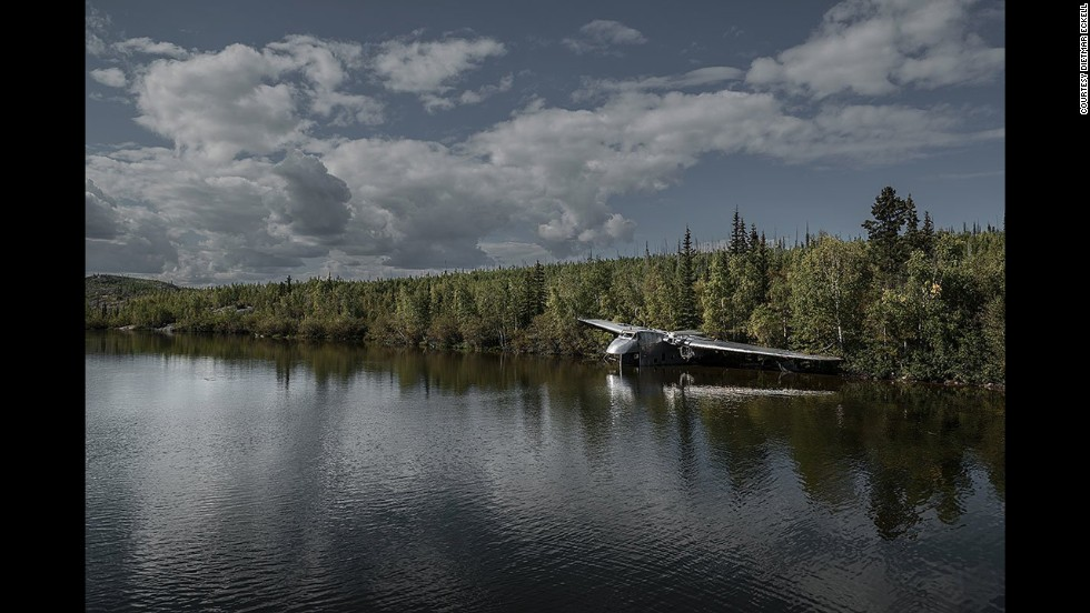 "A Bristol 170 Freighter, lost in 1956, appears to take a drink of water in Canada's Northwest Territories. Eckell's other photographic work of ""abandoned objects"" includes Cold War relics, overgrown adventure parks and Olympic sites."