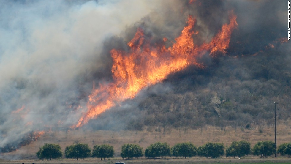 The wildfire burns out of control near an farm in Camarillo, California, on Thursday. Nearly 600 fire and law enforcement personnel were assigned to battle the blaze.