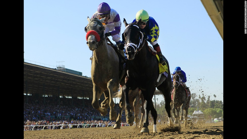 Horse Shanghai Bobby and Rosie Napravnik, right, race to first place ahead of Mario Gutierrez and He's Had Enough during the Breeders' Cup Juvenile race in Arcadia, California, on November 3.