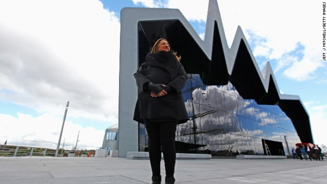 Architect Zaha Hadid, one of only two  women who have won the Pritzer Prize, stands in front of the Riverside Museum she designed for Glasgow, Scotland.