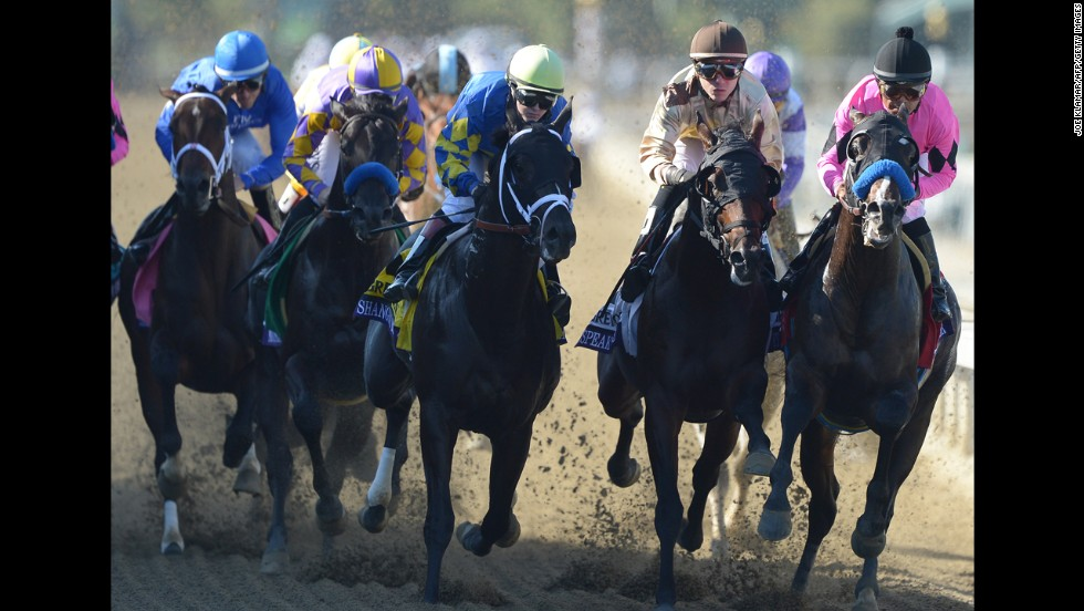 Napravnik and Shanghai Bobby, center, race down the track to win the Breeders' Cup Juvenile race.