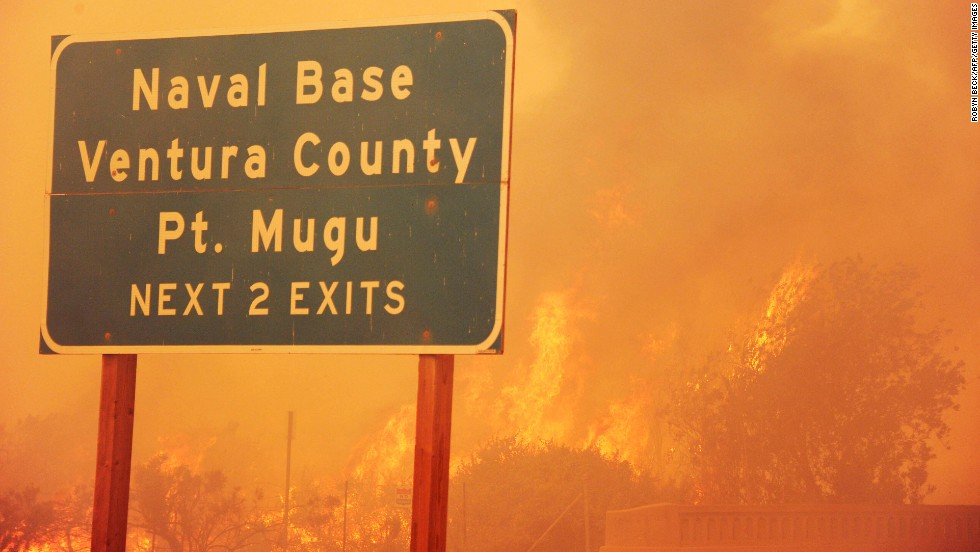 Fire burns along the Pacific Coast Highway close to the Naval Base near Point Mugu, California, on May 3.