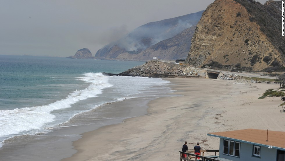 Lifeguards in Malibu, California, watch smoke rising from the wildfire burning near the Pacific Coast Highway on May 3.