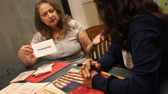 Volunteer citizenship mentor Diane Hall uses flash cards to help prepare a Korean immigrant for her citizenship exam