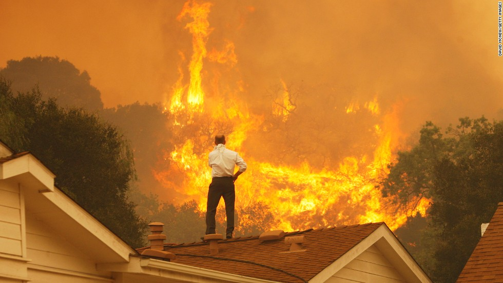 A man looks at approaching flames on May 3 in Camarillo.