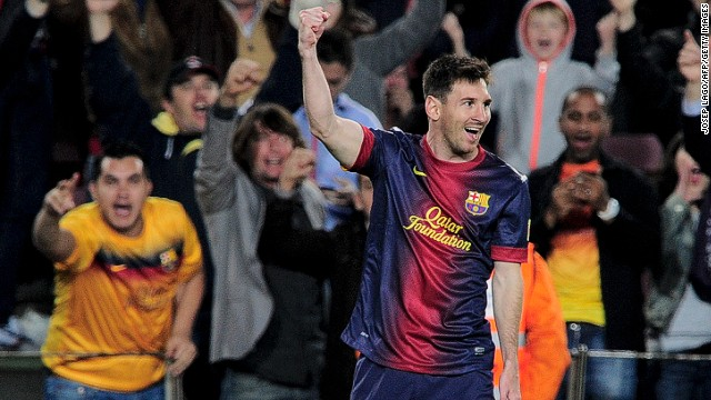 Barcelona forward Lionel Messi celebrates his first goal during Sunday's 4-2 Spanish league win over Real Betis.