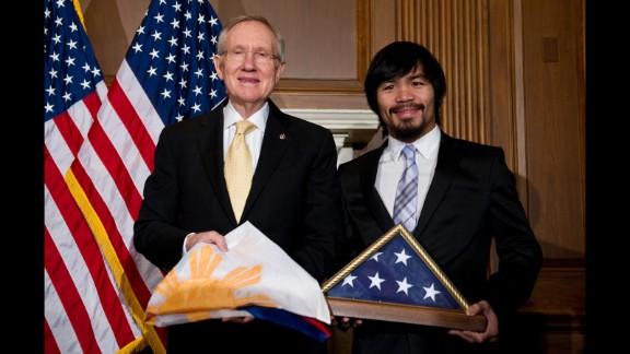 Pacquiao and U.S. Senate Majority Leader Harry Reid exchange flags in Washington on February 15, 2011.