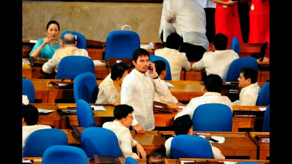 """Pacquiao attends a session of the Lower House as congressman representing his home district of Sarangani during the State of The Nation address of President Benigno """"NoyNoy"""" Aquino on July 26, 2010."""