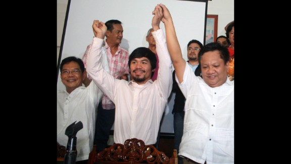 Pacquiao celebrates with local officials during his proclamation as congressman of Sarangani province in May 2010.
