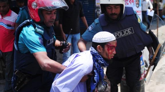 Bangladeshi police detain a protester on May 5.