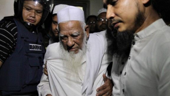 Bangladeshi police escort Allama Shah Ahmad Shafi, an Islamic leader and Hefazat-e-Islam movement veteran, from Dhaka on May 6.