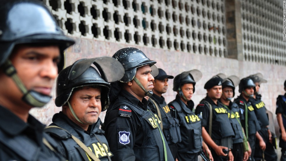 Rapid Action Battalion personnel stand guard following a clash between police and Islamists in Dhaka on May 6.
