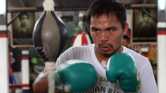 Manny Pacquiao is known the world over for his boxing abilities, but in the Philippines he's also a national hero beyond the ring. Click through to see moments of Pacquiao's life.