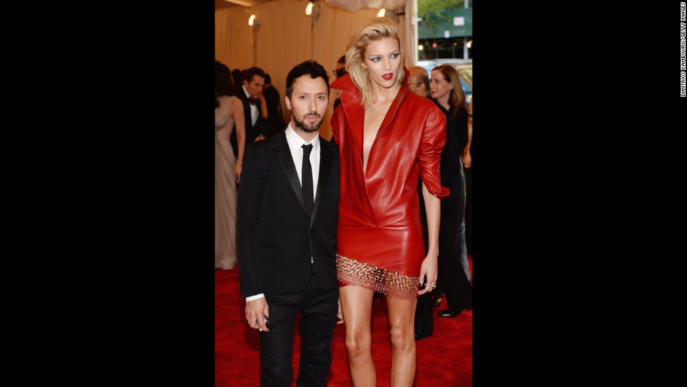 Designer Anthony Vaccarello and model Anja Rubik attend the gala.
