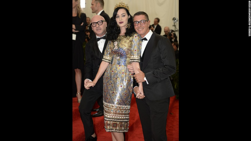 Stefano Gabbana, left, Katy Perry and Domenico Dolce attend the gala.