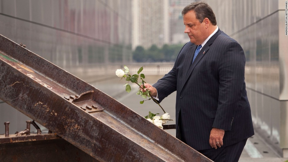 Christie lays a white rose on wreckage pulled from ground zero during the dedication for the Empty Sky Memorial at Liberty State Park on September 10, 2011, in Jersey City, New Jersey.