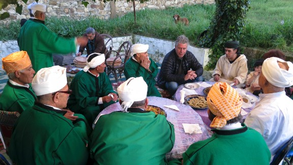 Bourdain shares a meal with Bachir Attar and the Master Musicians of Jajouka at Attar