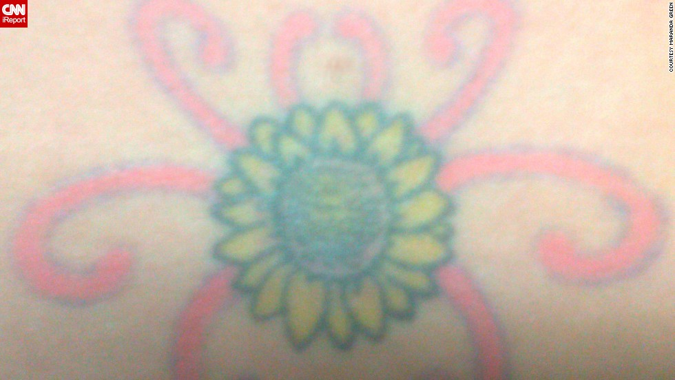 "Maranda Green's mother passed away from complications of <a href=""http://ireport.cnn.com/docs/DOC-966677"">polycystic kidney disease</a> when she was just 14. At 19, Green was diagnosed with the same condition. The meaning of her sunflower tattoo is twofold: It's in memory of her mom, and it's a symbol of her own resolve in fighting the disease. Why a sunflower? ""My mom always loved those big, seemingly flowing fields of sunflowers,"" said Green. The tattoo is, of course, on her lower back -- over the kidneys."