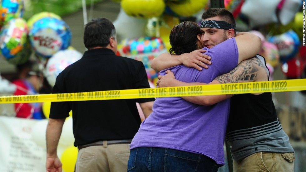 Friends and relatives gather in front of the family house of DeJesus on May 7.