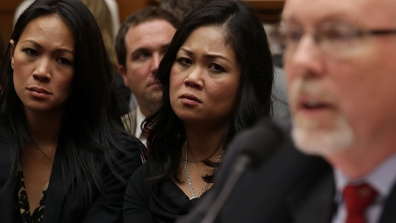 Dorothy Narvaez-Woods, center, listens as Hicks testifies. She is the widow of Navy SEAL Tyrone Woods, who was killed in the attack.