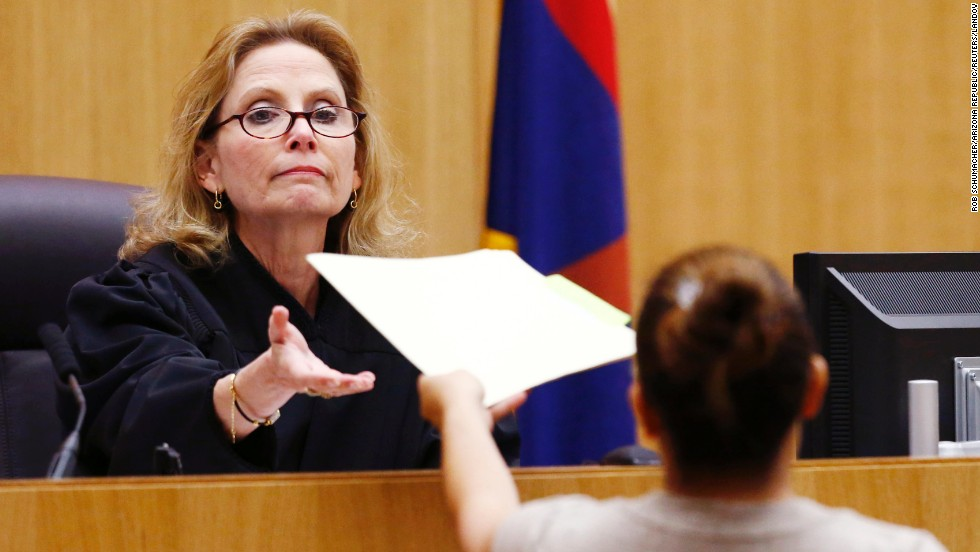Judge Sherry Stephens receives the jury's decision on May 8. The jury, which has been in court since January 2, heard closing arguments on Friday, May 3. Jurors deliberated for 15 hours and five minutes.