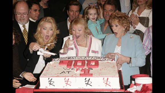 """Cooper, right, celebrates the 900th week of """"The Young And The Restless"""" as the No. 1 rated daytime drama with fellow cast members on April 6, 2006."""