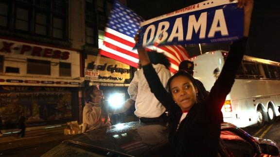 Residents in Harlem celebrate Barack Obama`s first election as president November 4, 2008, in New York City.