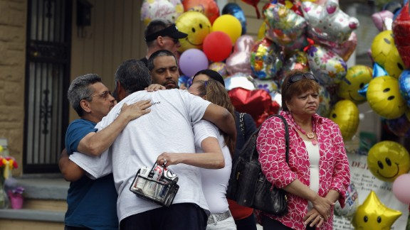 """Relatives of kidnapping victim Georgina """"Gina"""" DeJesus hug after she returned to her parents' home in Cleveland on May 8."""