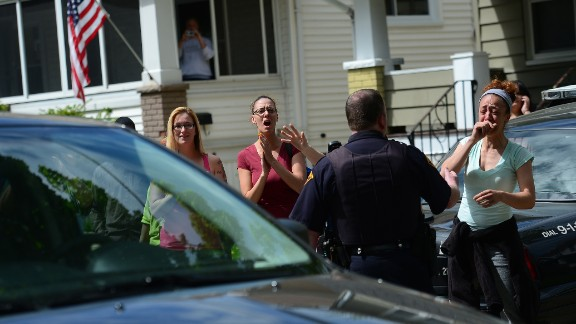 Friends and neighbors cheer as a car carrying Amanda Berry arrives at her sister
