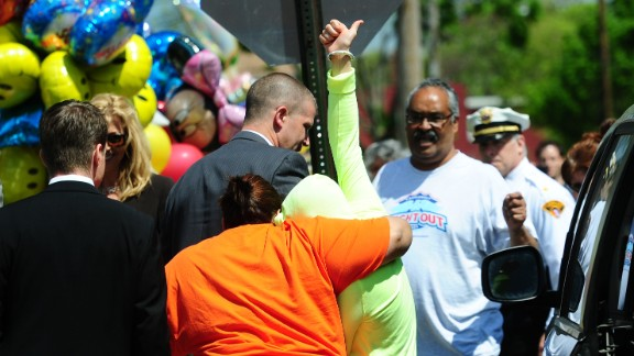 Gina DeJesus gives a thumbs up as she arrives at her family's house in Cleveland on May 8.