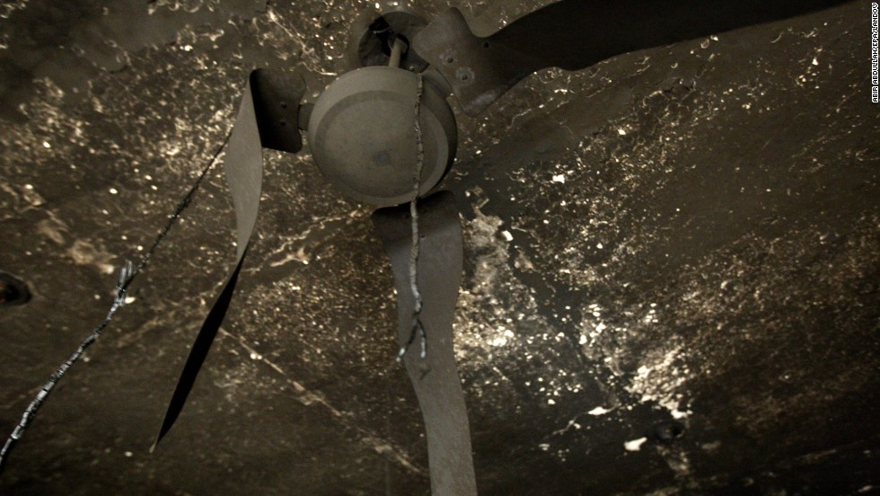 Arms of a ceiling fan were melted in the fire.