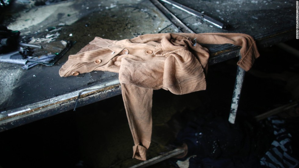 Clothes lie on singed surfaces.